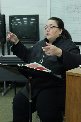 Choir instructor Magda Silva, directs her choir in a song they will be performing for their winter concert.