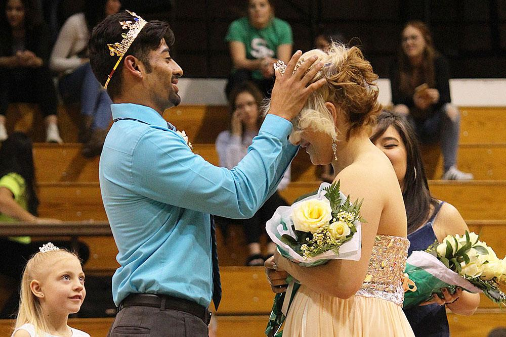 Homecoming King Andy Ortiz crowns Homecoming Queen Myriam Rubio at the ceremony between games, Saturday, Feb. 18 in the Greenhouse.