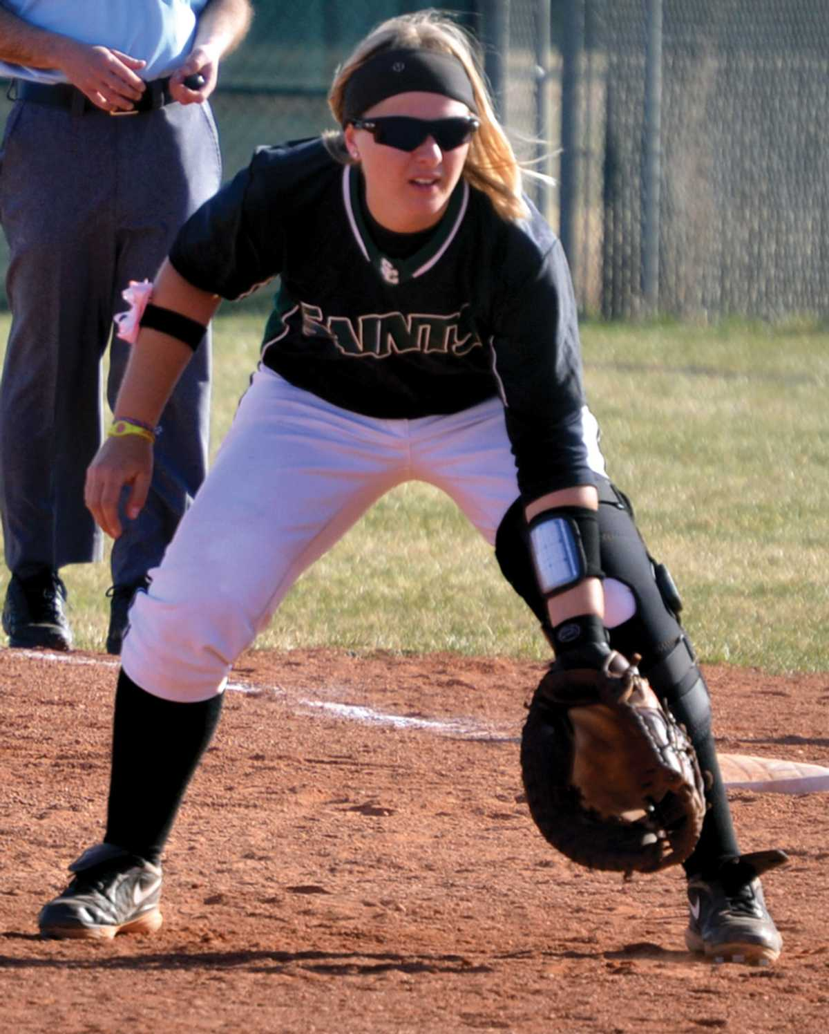 Crusader photo/Jose Medrano Lady Saint Stephanie Mark stands at first base waiting for a hit during the Jayhawk West conference opener against Butler on March 6 at home.