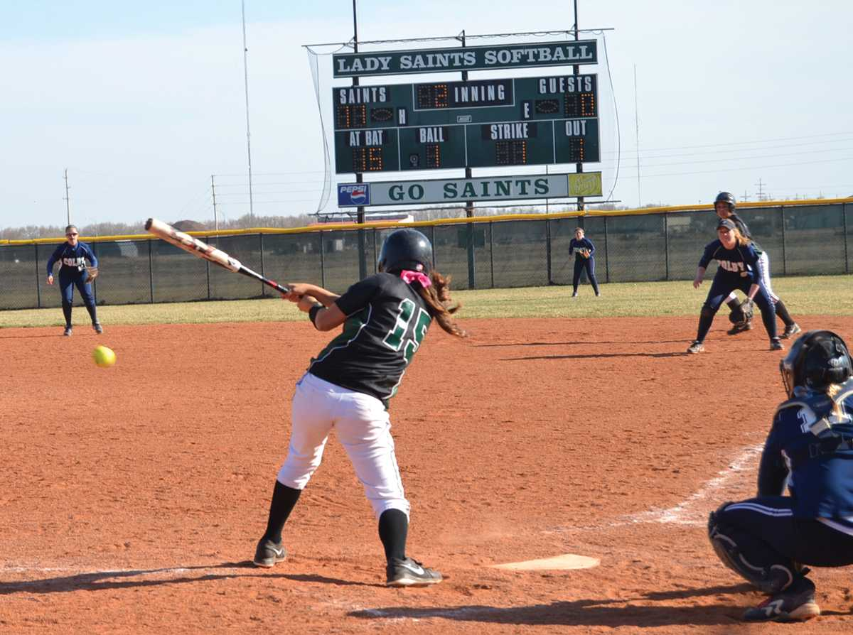 Crusader photo/Jose Medrano Lady Saint Marissa Chavez, No. 15 hits during the Lady Saints double header against Colby March 27.