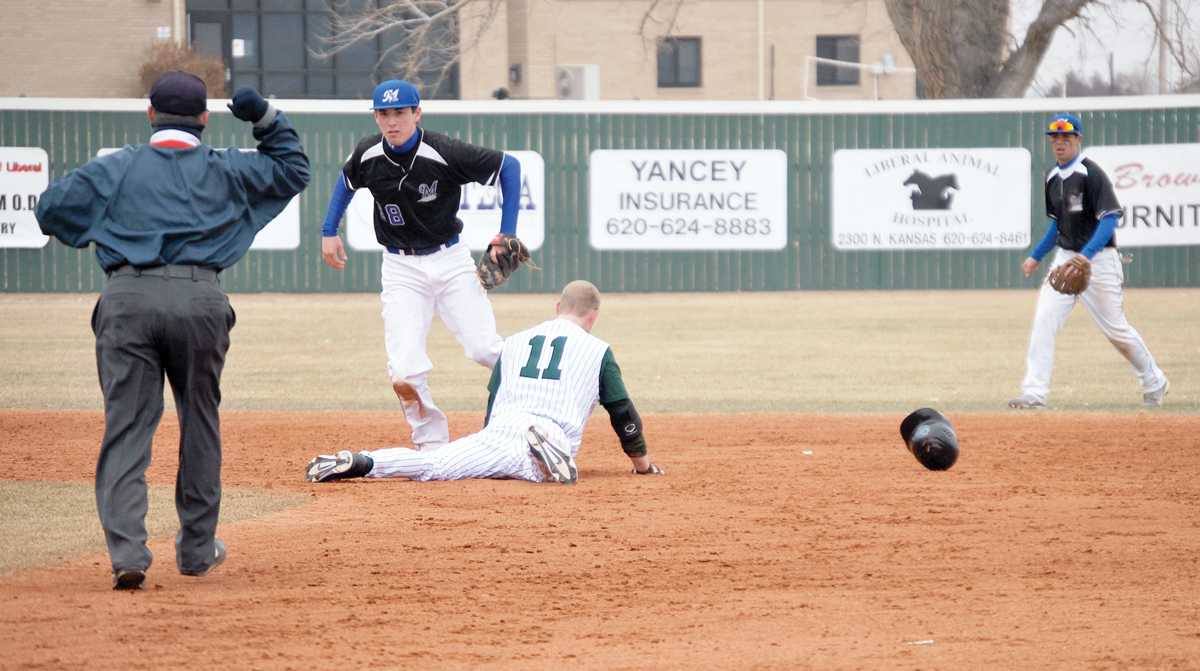 Crusader photo/Kelci Bedingfield Seward baseball player Reed Thompson attempts a slide into second base but gets tagged by the McCook shortstop and called out. The Saints went on to defeat McCook with the score of 7-3 on a freezing cold season opener Feb. 3.