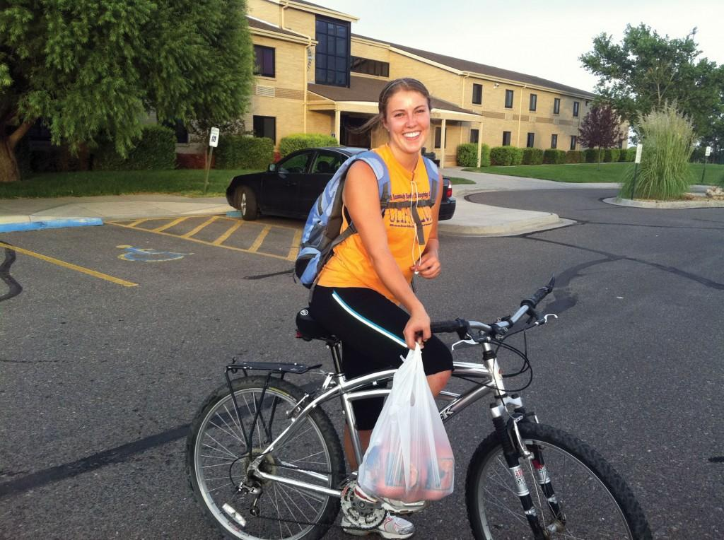Rochelle St. Amand, who recently moved to Liberal, returns from a bike ride to Wal-Mart to purchase groceries.