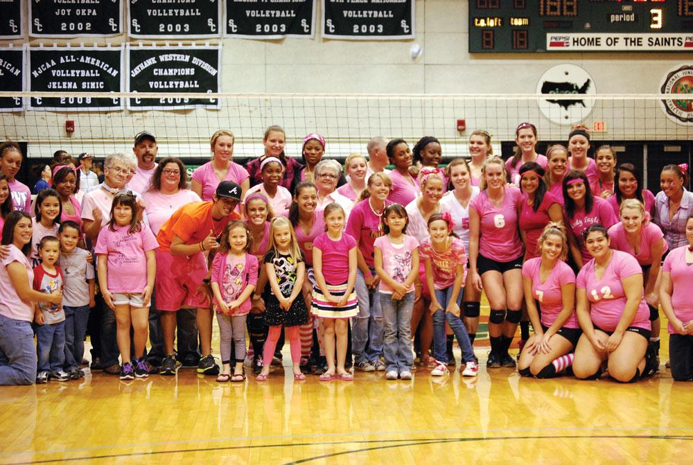 Digging the Pink: Lady Saints defeat Cloud County