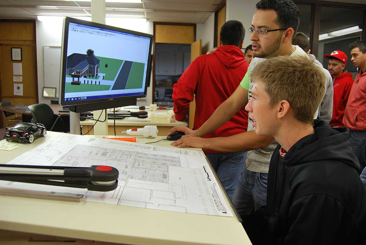 On Manufacturing Day Friday, Antolin Ortiz, a sophomore student at Seward, demonstrates Computer-aided design (CAD) for the architecture. Keith Evans, a high school student, is interested in the drafting.  According to Evans, he plans to enroll in SCCC/ATS to study drafting technology after he graduates.  Crusader photo/Sachie Shiba