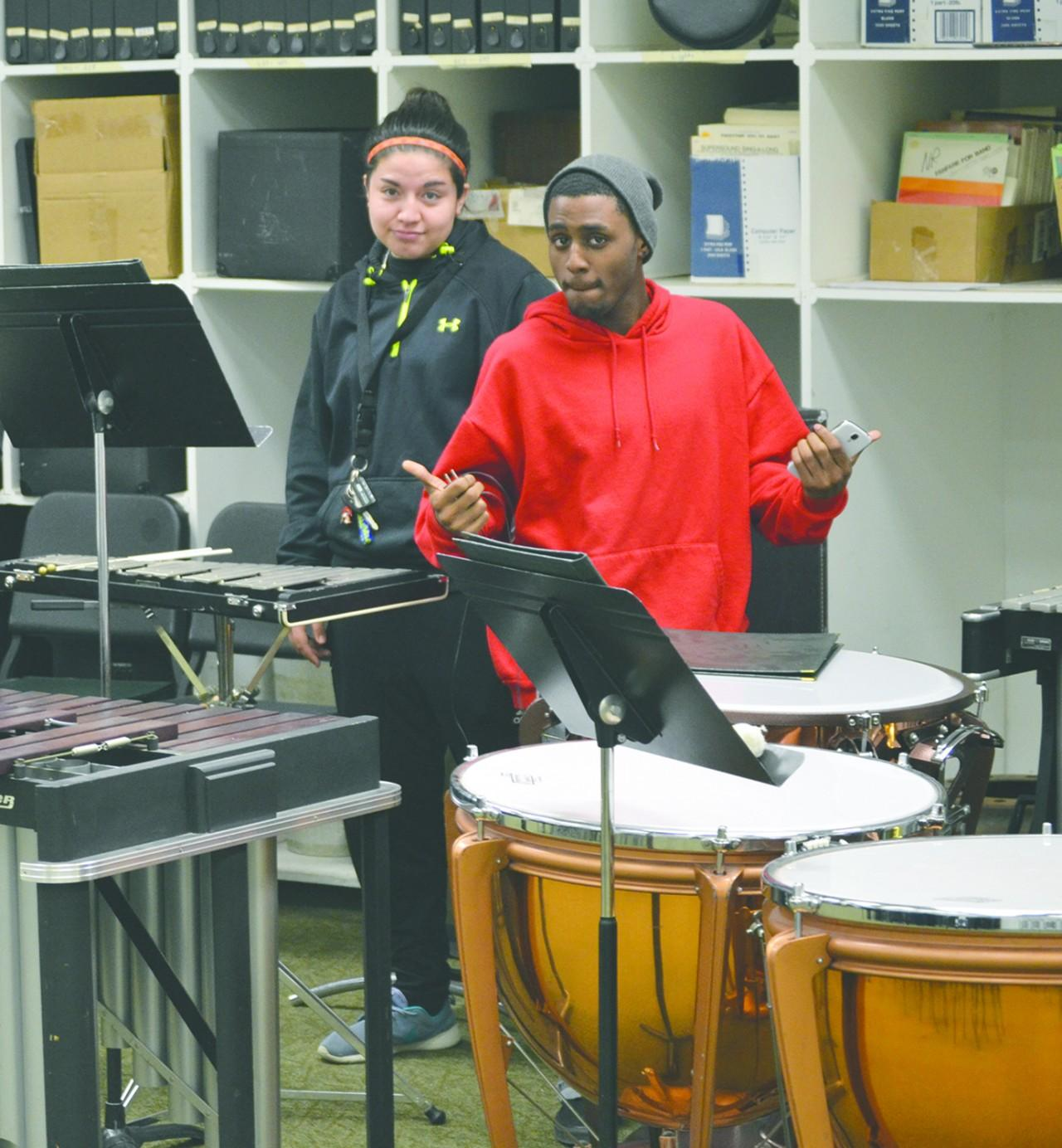 Alysha Espinoza and Cedric Mitchell practice for annual winter concert. Crusader photo/Kim Nguyen