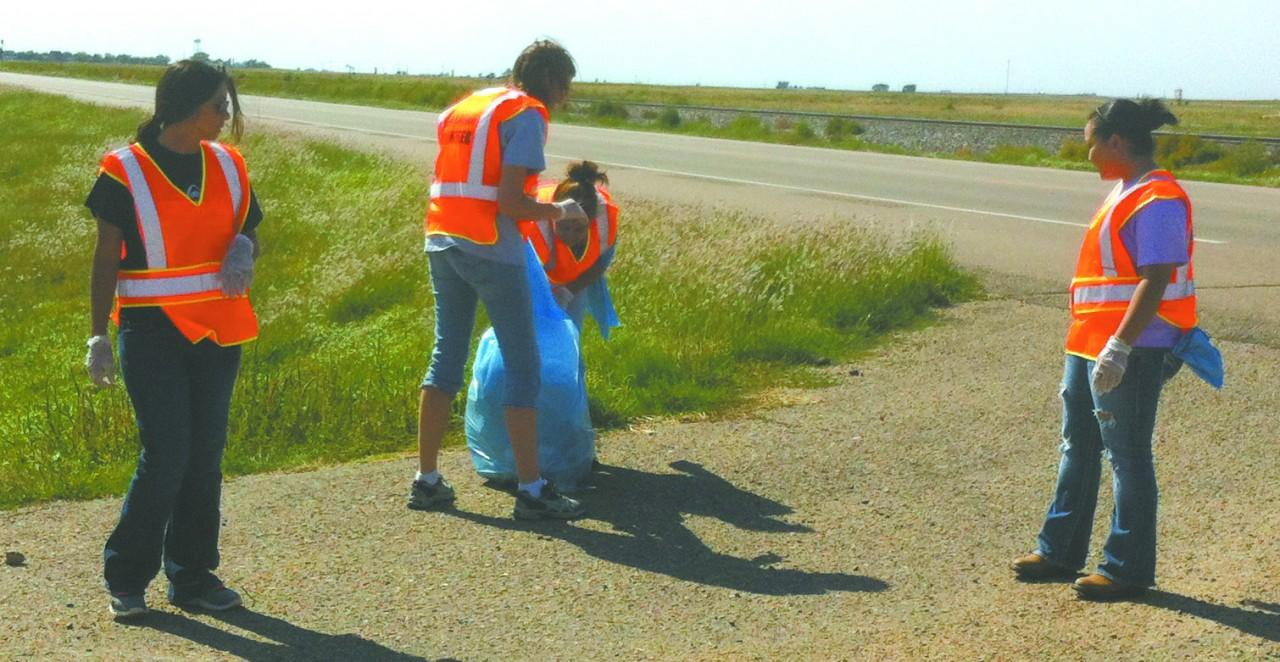 PTK members Selene Perez, Beth Beard, Josefina Alvarado and Nyra Rin remove trash on Highway 54. PTK does this biannually.