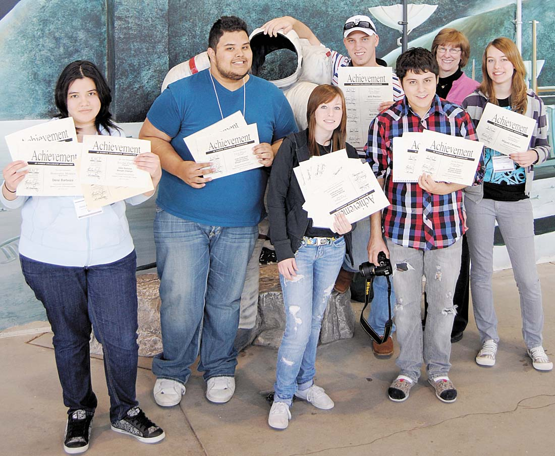 Courtesy photo The Crusader staff shows off the 24 individual awards earned at the Kansas Associated Collegiate Press conference in Hutchinson April 18-19. The staff was also a silver medalist for two-year newspapers.