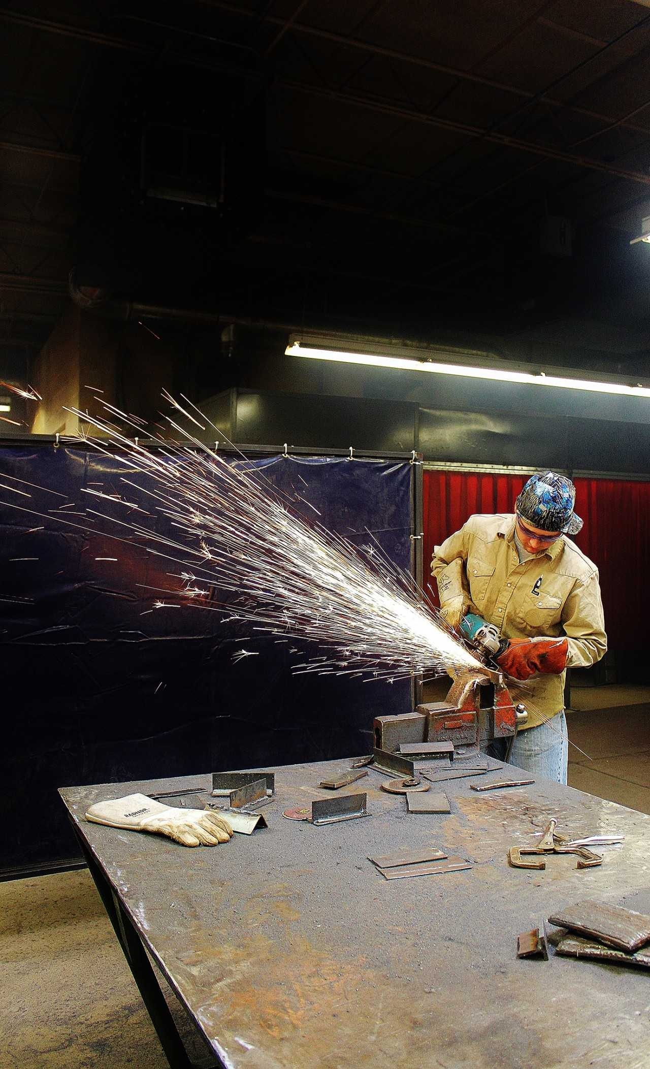SCCC/ATS student and presidential scholar Evan Thornton grinds some excess off of his structural metal project in the Area Technical School's welding shop. Crusader photo/Xochitl Gonzalez