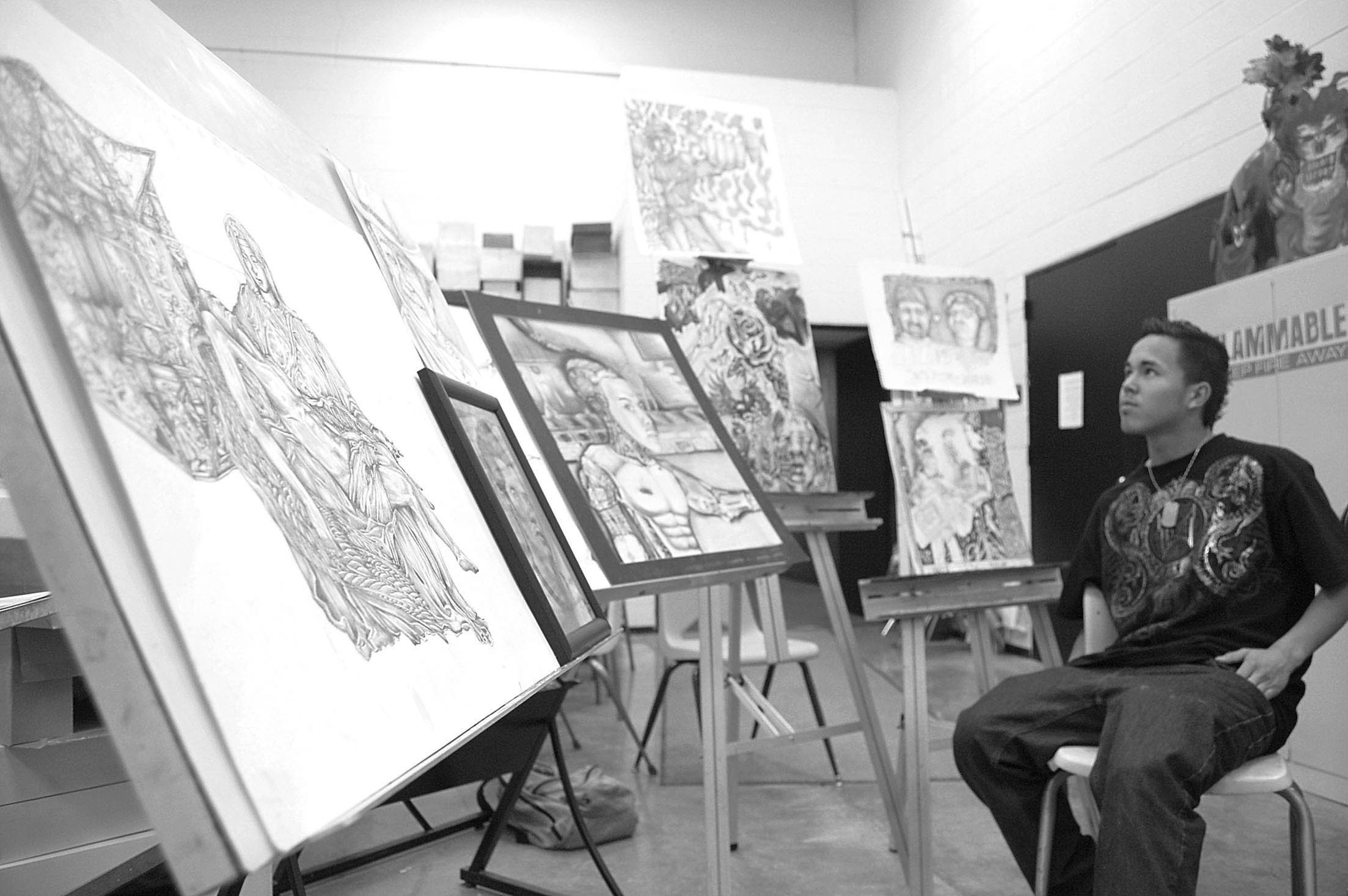 As Omar Rios explains his idea for his latest drawing of having a satisfied Michelangelo peering over several of his classic works of art, one couldn't help but see a resemblance as Rios looked over some of his own favorite drawings.