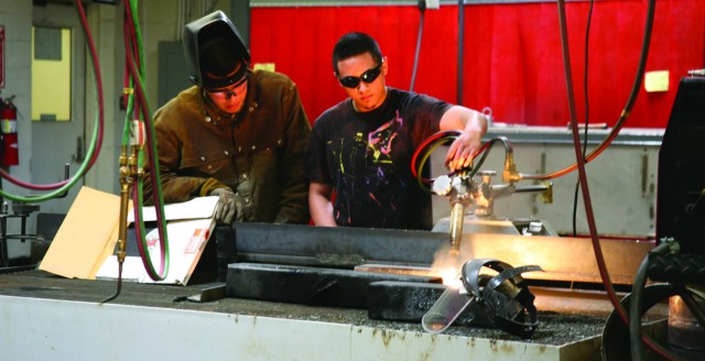 Courtesy photo/ Pam Freeman Rey Lujan and Juan Cerda demonstrate their work in the welding department during the Spring Fiesta and Car Show. The technical school had an open house during the fiesta. More photos on page 6.