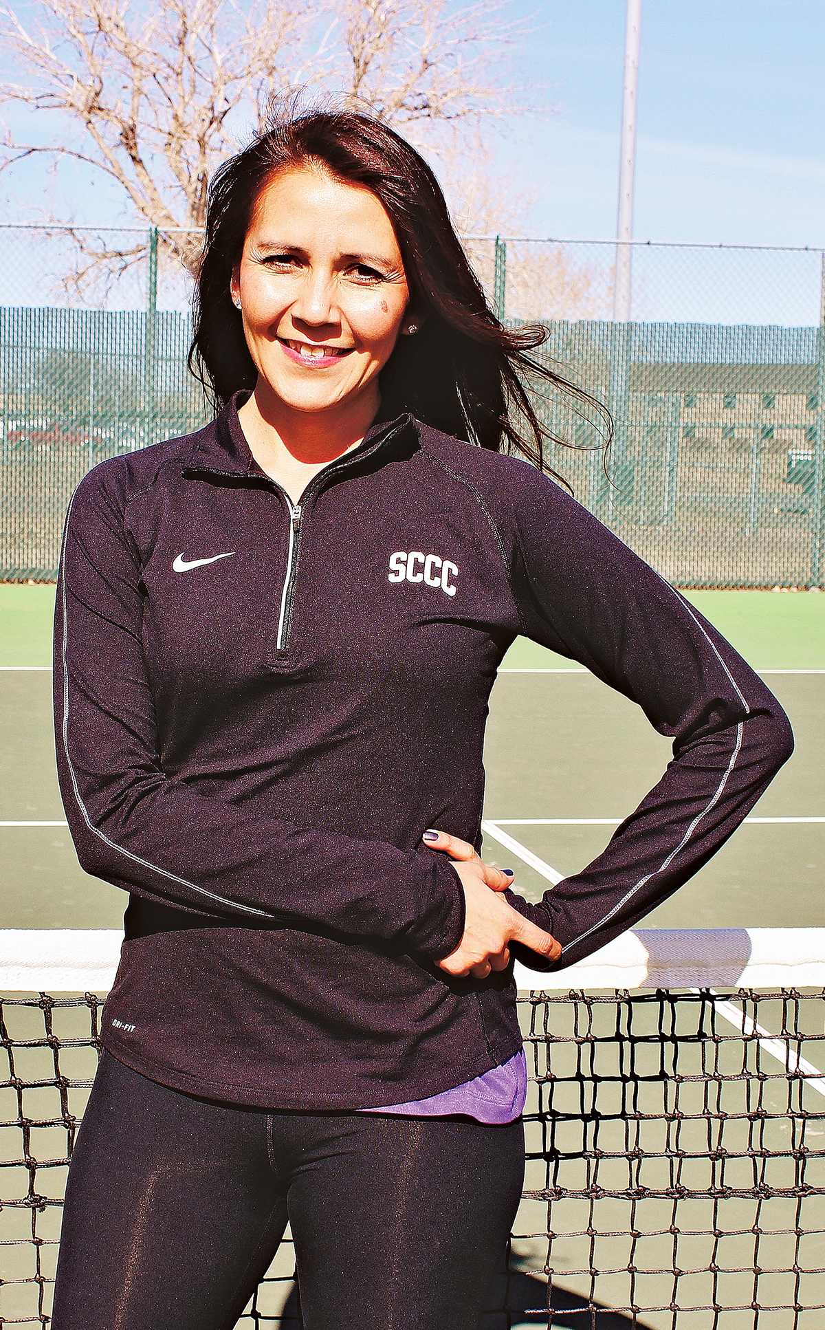 Crusader photo/ Xochitl Gonzalez Assistant tennis coach Nadine Mein out at the courts for practice.