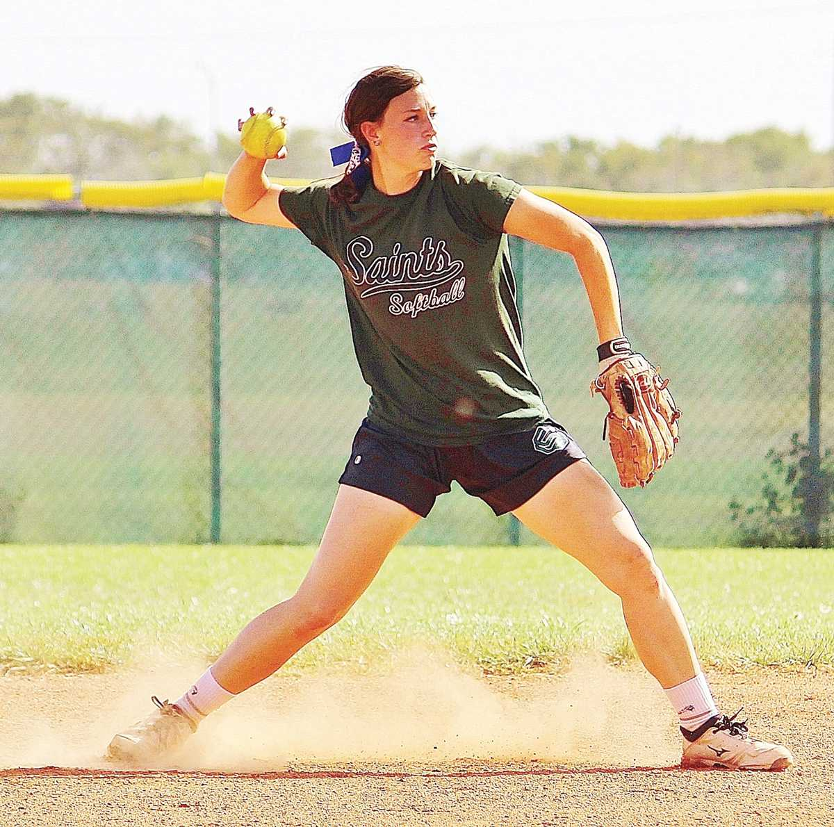Crusader Photos/Xochitl Gonzalez Lady Saints softball shortstop Grace Petersen throws the ball to a teammate on second base during a drill in practice Tuesday. The Lady Saints will be playing against Northeastern Junior College on Saturday at 3 p.m.