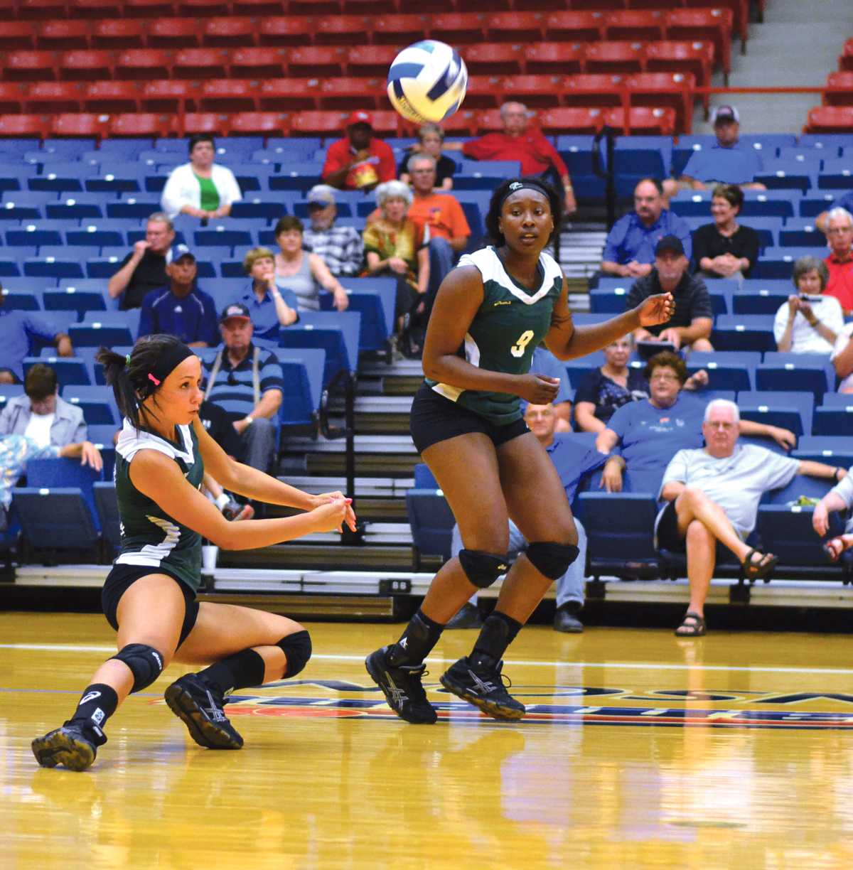 Crusader photo/Maria Lara Carolina Gasparini digs the ball in an effort to return a kill attempt from the Hutchinson Blue Dragons. Gasparini ended the night Sept. 17 with nine kills and 13 digs.