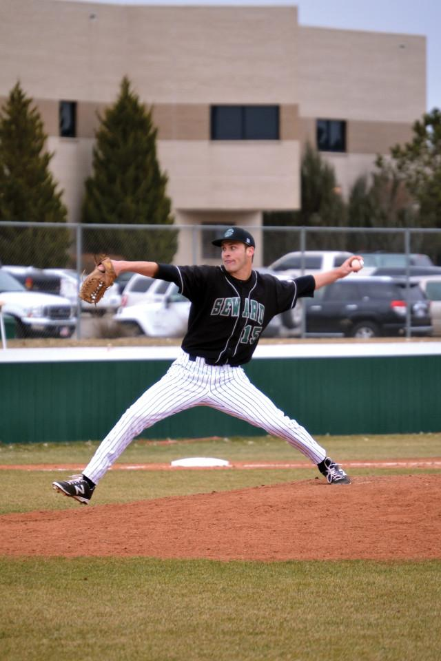 Crusader photo/ Efren Rivero  Hayden Howard pitches on the cold season opener against McCook Community College. Saints have a season record of 3-4 after having an early start to the season. Saints will face Odessa College Saturday.