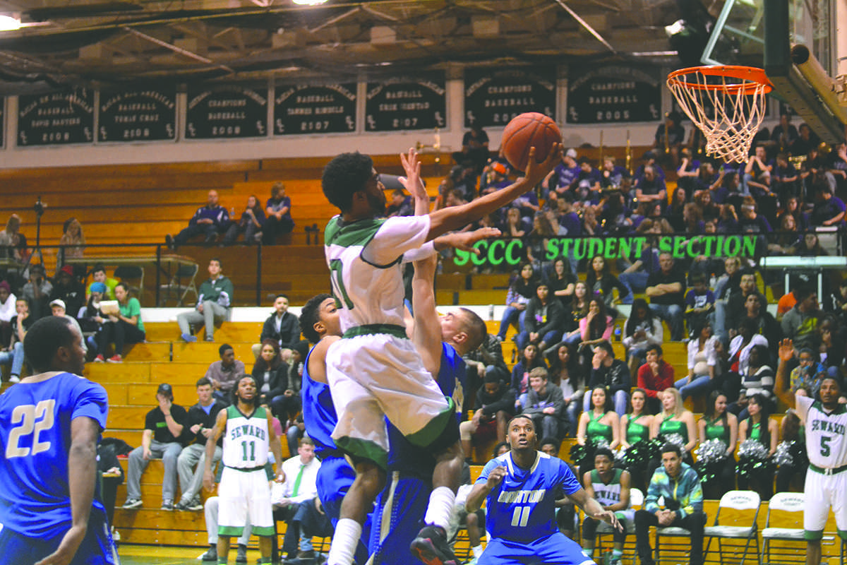Crusader photo/Diana Chavira Kevin Sims goes up for one of his 26 points scored for the night against Barton County. Sims reached a new career high that included shooting 17 times from the free throw line and helping put Seward in the lead.