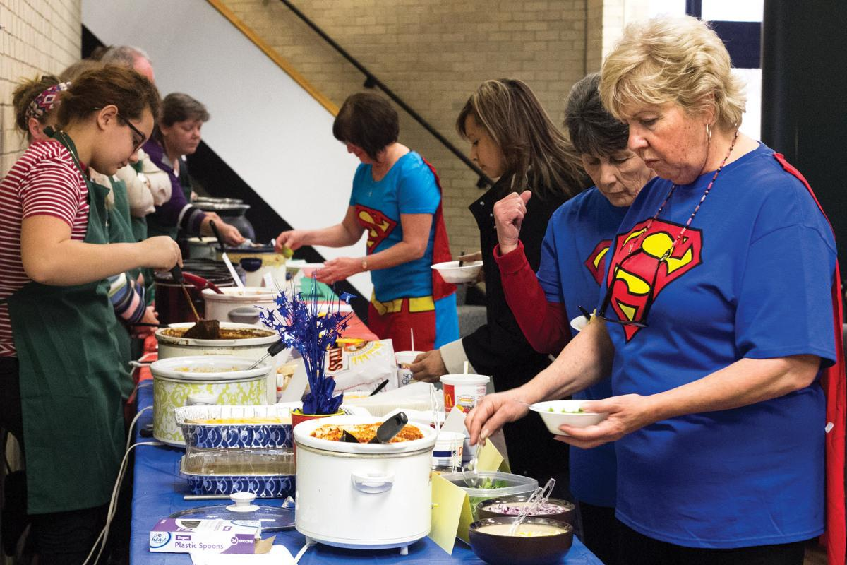 Crusader photo/Maria Lara Souper Bowl for Scholarships at Seward County Community College helps raise money for scholarships through SCCC/ATS Foundation on Thursday, Jan. 29. Three deans, Celeste Donovan, Cynthia Rapp and Janese Thatcher dressed in Superman attire to try the entries.