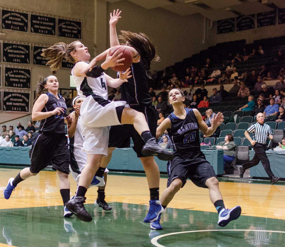 Crusader photo/ Jakub Stepanovic Kyndal Davis aiming for the basket in the game against the Lady Cougars from Barton at the Green House, Feb. 19.