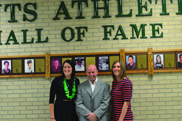 Crusader photo/Diana Chavira Tegan Cunningham, Tim Forkner and Jamie Talbert stand before the Saints Athletics Hall of Fame after unveiling it together for their induction as the Class of 2015.