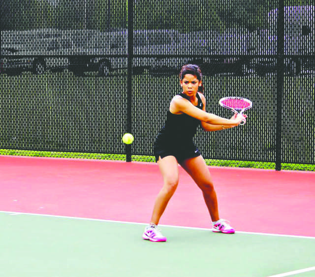 Crusader photo/Xochitl Gonzalez Kellyn Peters returns a ball in the NJCAA Region VI tournament. Peters finished as runner-up in singles and third in No. 2 doubles.