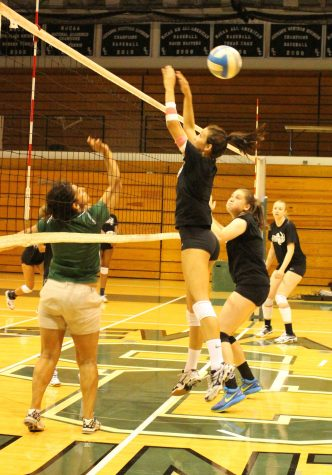 Saints volleyball practices their net game.