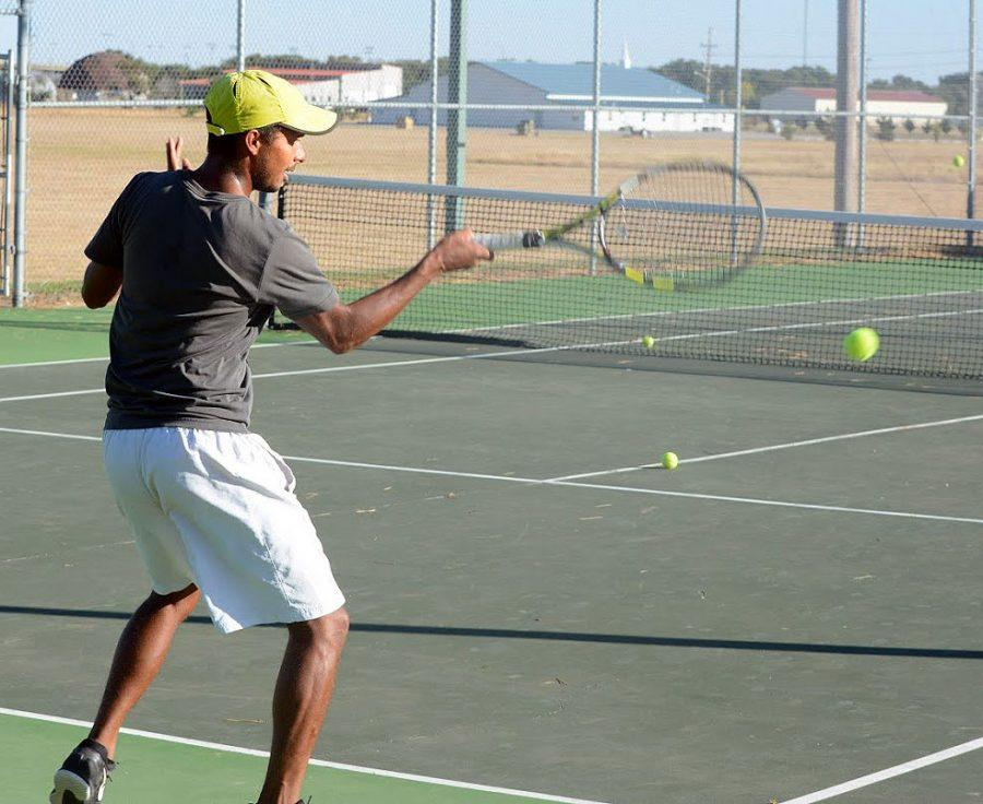 Carlos Añez runs through drills during tennis practice. He and his doubles' partner, Ondrej Nice, will represent SCCC at the NJCAA national tournament this weekend. It's the first time Saints tennis has qualified for this event. Both the men's and women's teams have