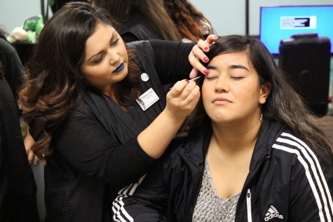To help brighten up her face for National Student Day, Sabrina Urias gives Judith Perez a glitter star on her cheek.