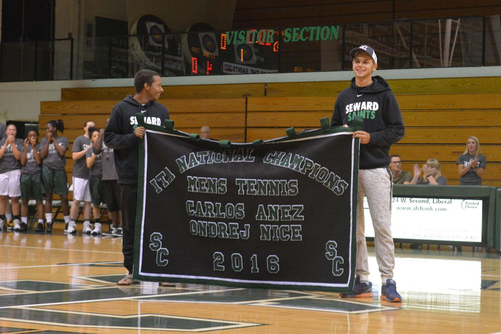 Welcomed as champions, Ondrej Nice and Carlos Añez are presented their banner for winning the NJCAA Men's Doubles National Championship. The duo is only the second in SCCC history to take the title.