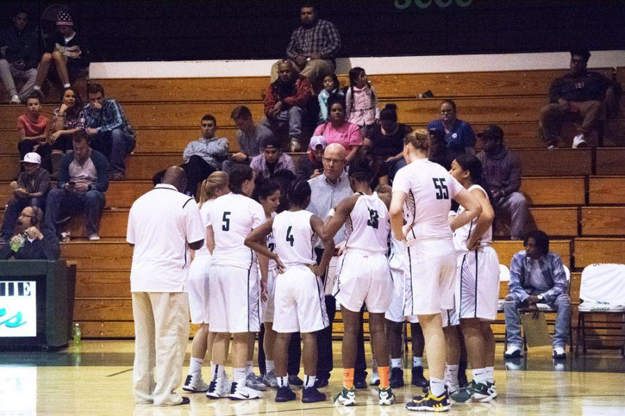 Coach Toby Wynn gives his team some encouragement during a time out.