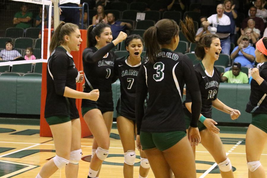 After taking an important point lead, the Lady Saints celebrate their well executed play.
