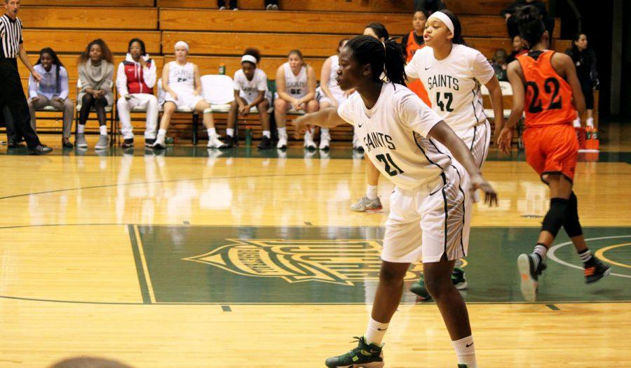 Manuela Fungate retreats to defend the basket against Neosho Community College.