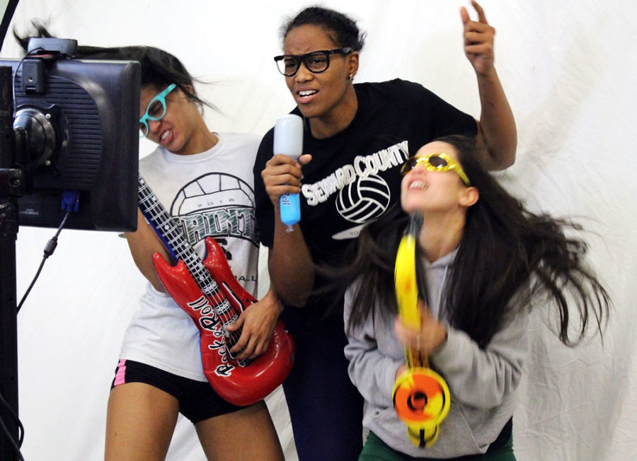Members of the Lady Saints volleyball team ham it up for the camera while making a flip book.