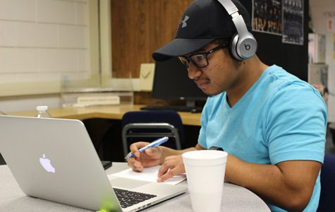 Studying his major in engineering, Jorge Mendoza catches up on his work in the student success center.
