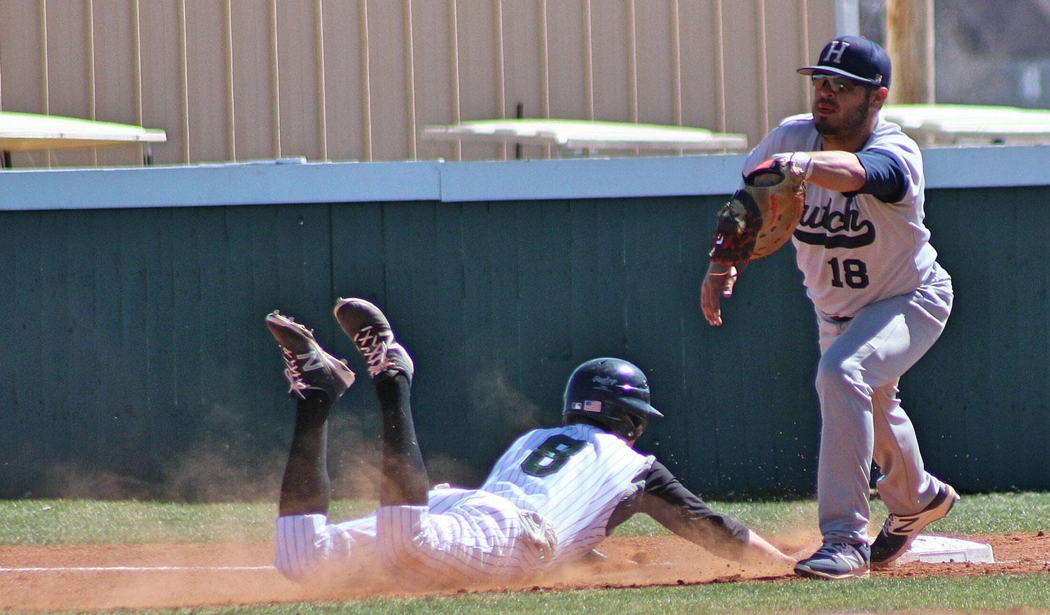 Outfielder Timothy Fitzgerald gets down and dirty with an attempt to make it back to first base. Fitzgerald has managed to get one RBI this season.