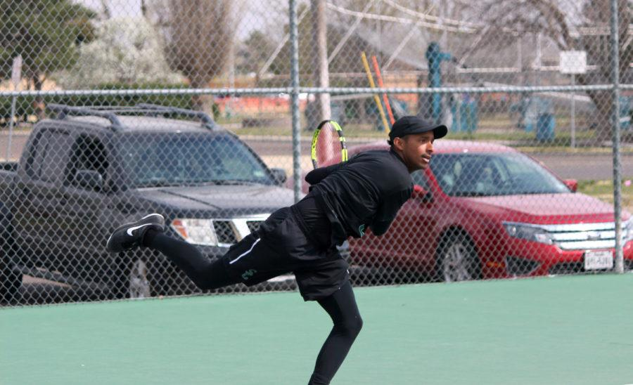 Sophomore Carlos Anez returns the ball to his opponent. Anez started the Saints off with a win in singles downing James Ryan 6-3, 6-4 to put Seward up 3-1.