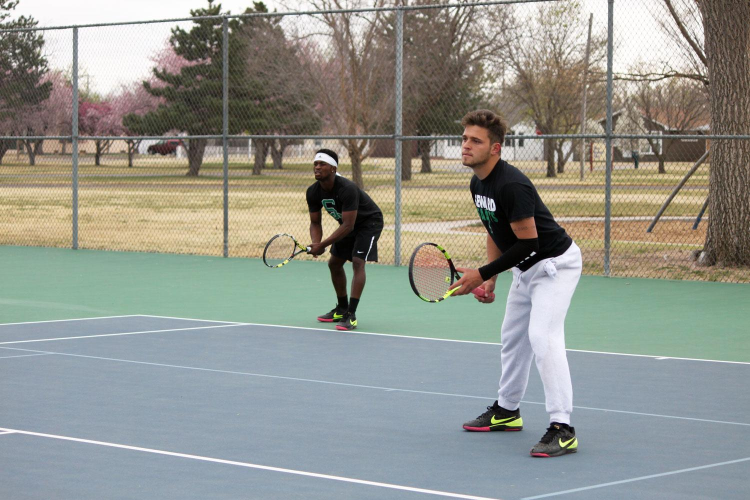 Sophomore Alex Moshele and freshman Gabriel Nery get ready to receive the ball against their opponents Colorado State. Moshele took a straight sets win at #2.