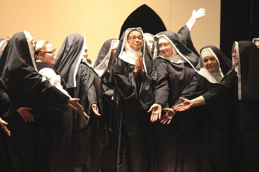 The+nuns+welcome+Deloris+into+their+church.+Deloris+is+only+there+to+hide+away+from+Vince.