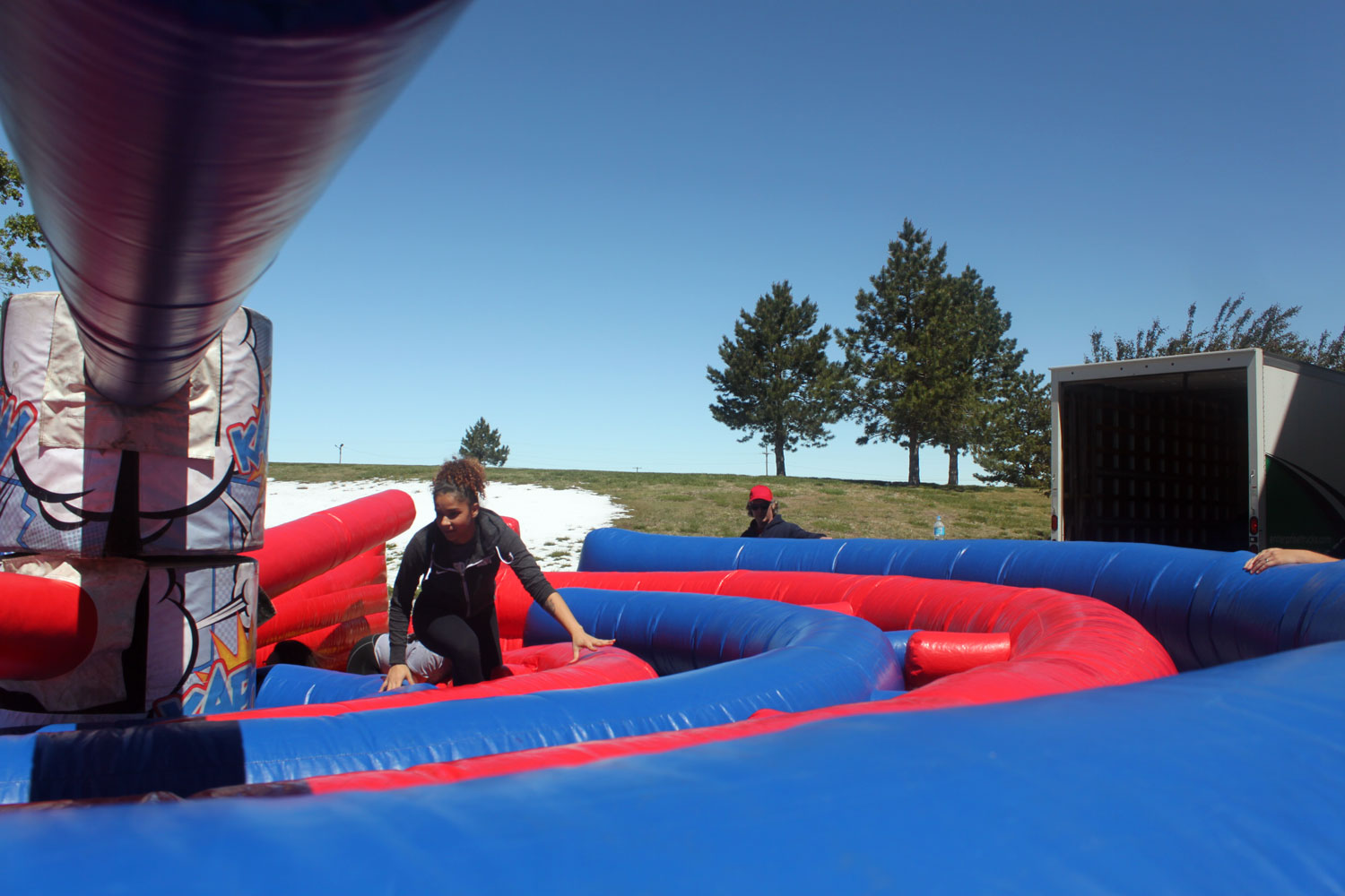 """Viviane Santana makes her way through the """"KAPOW"""" obstacle outside the student center on May 1. For one of the most stressful weeks of school, SCCC brought fun and entertainment before finals."""