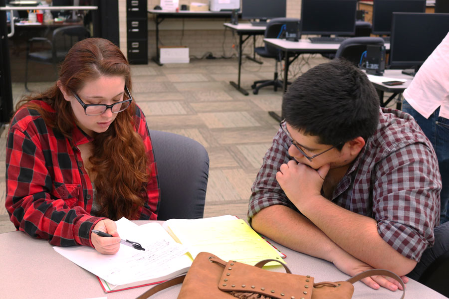 "Isabella Russell receives help from her tutor, Jose Cardenas, on trigonometry homework. ""It's a really good class. I really enjoy having Heather [Hannah] as a teacher but I just struggle learning trigonometry,"" said Russell."