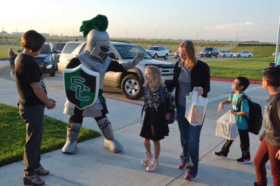 Louie the Saint greets students on the first day of school at Prairie View Elementary School. Seward County Community College is partnering with the elementary school by having college students interact and spend time with kids each week.