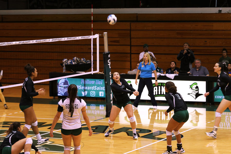 Sophomore Giovanna Kuntze attempts to save the ball after teammate dives to set the volleyball.