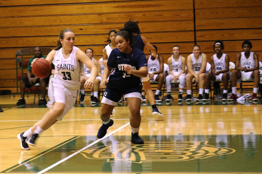 Freshman Chelsea Lazenby attempts to dribble past by an Otero defender.