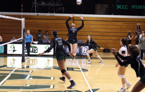 Esmadar Tavares prepares to set the ball to Giovanna Tapigliani. The Lady Saints remain undefeated on their home court.