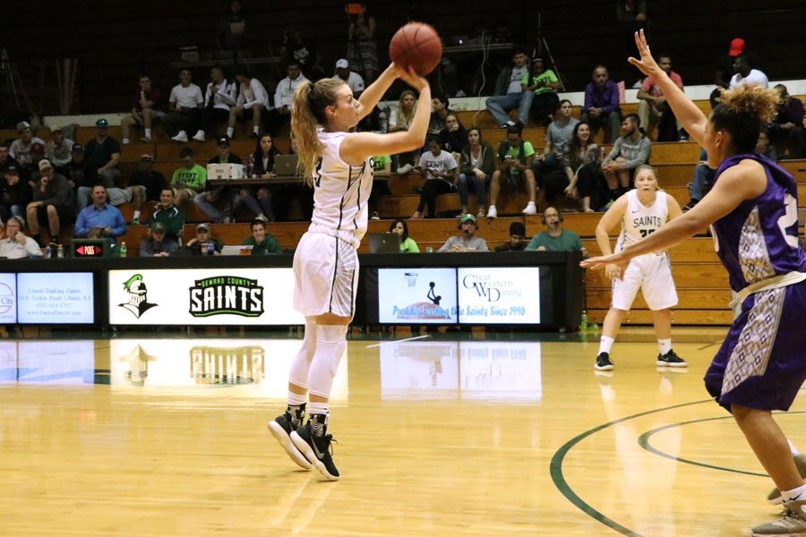 Freshman Amy Scott swishes a three pointer against Butler Community College in the first half.