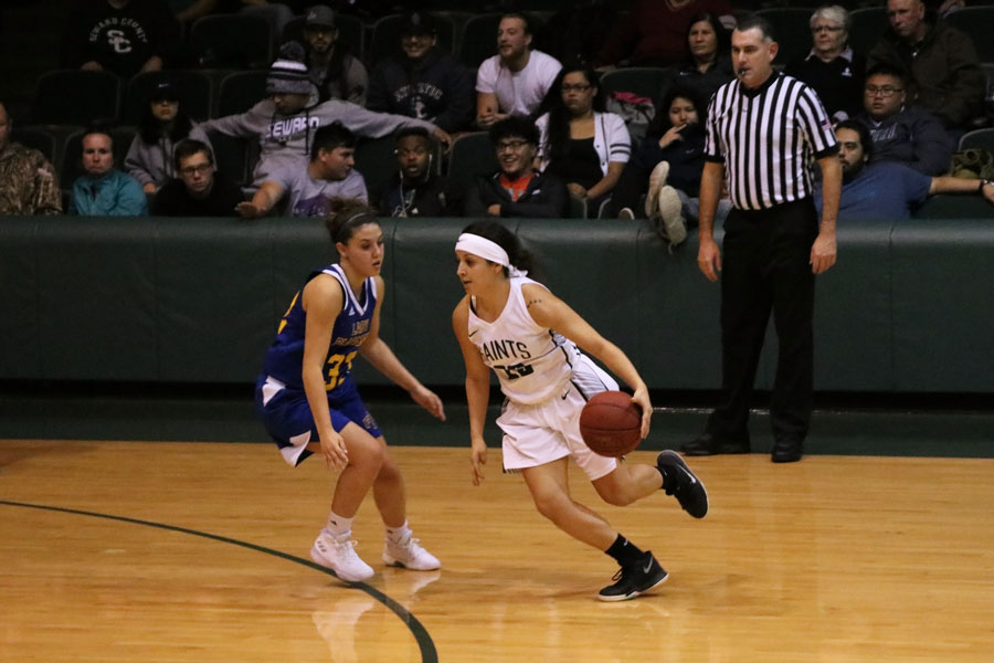Sophomore Vanessa Caro dribbles past her opponent to make an easy lay up. Vanessa scored 12 points against Frank Phillips College.