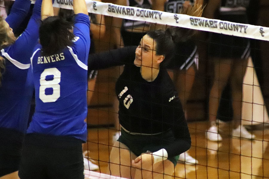 Right Side, Giovanna Tapigliani, hits the ball towards the opponent, Pratt. Tapigliani was the only Lady Saint to end with double-digit kills for the night.