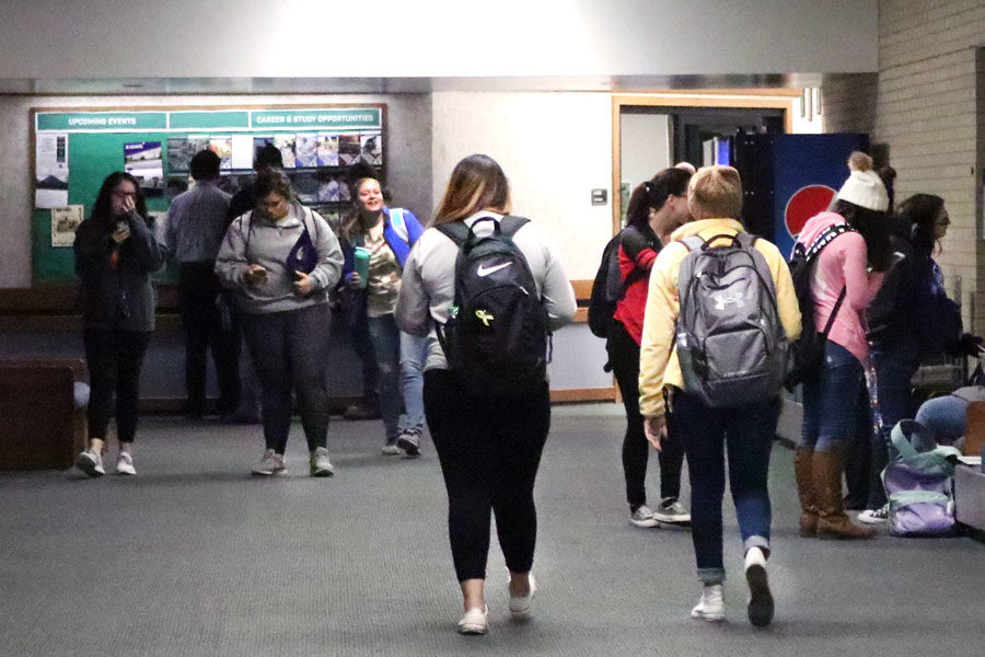 Student's walk the halls carrying their backpacks full of all their random necessities.