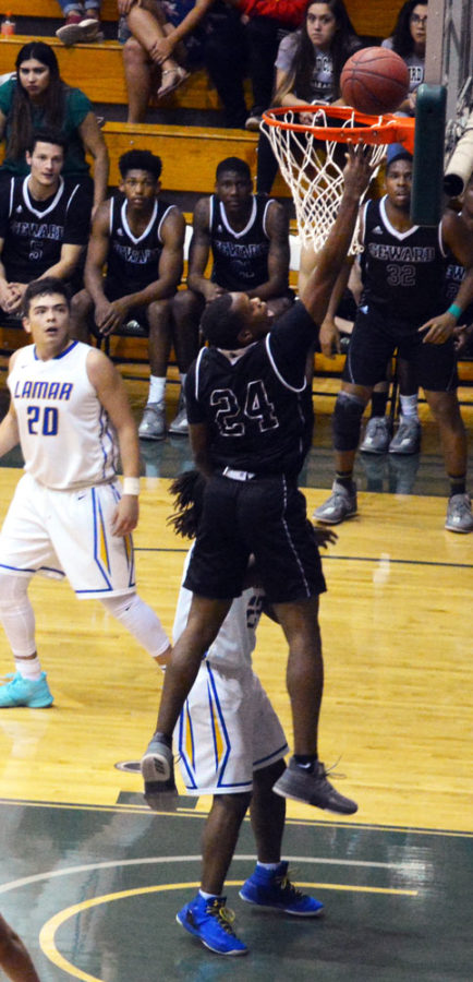 Freshman Jordan Mitchell tries to finish at the basket after crossing his opponent.
