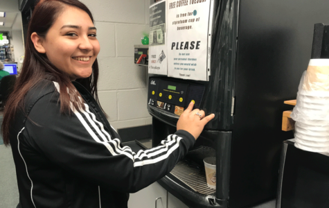 Angelica Alfaro enjoys free coffee in the bookstore on Tuesday, Nov. 28.
