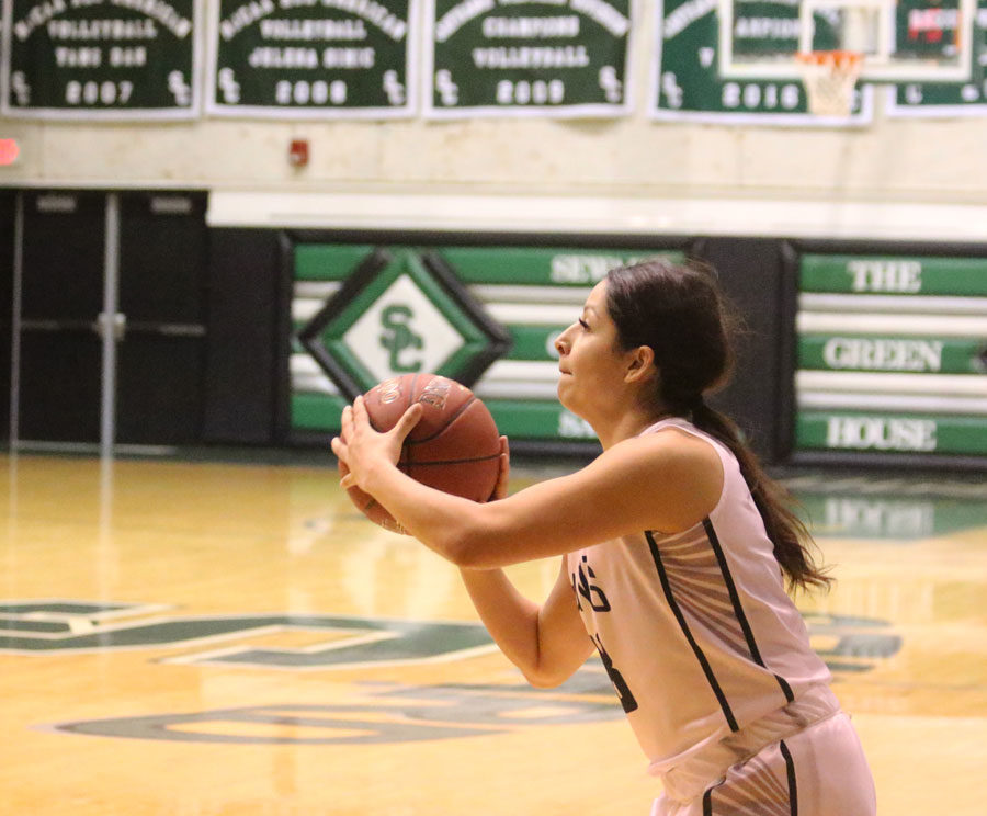 Vanessa Caro sets up to shoot a three pointer in the second half against Barton Community College.
