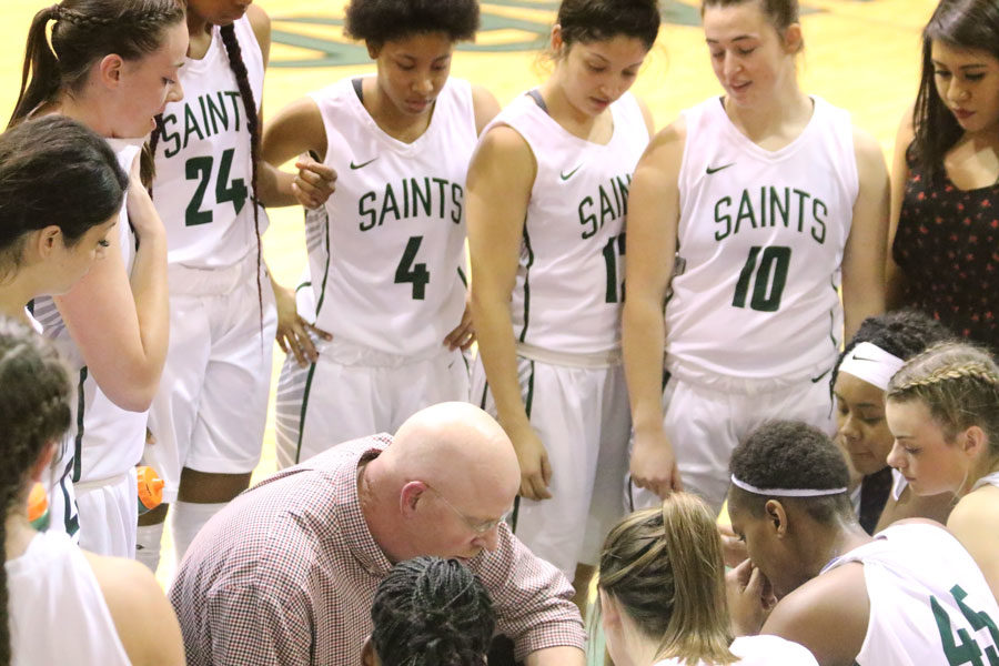 SCCC Women's Basketball Head Coach Toby Wynn calls a time-out during the first half to discuss a game plan.